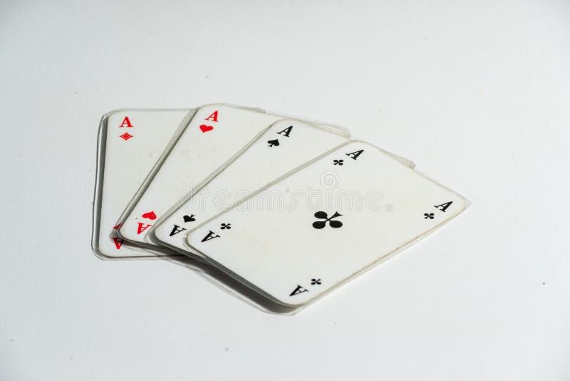 Quatro áss no branco imagem de stock royalty free
