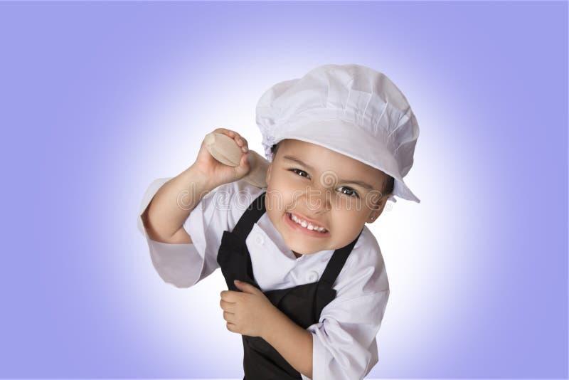 Quatro anos de menina do cozinheiro chefe imagens de stock
