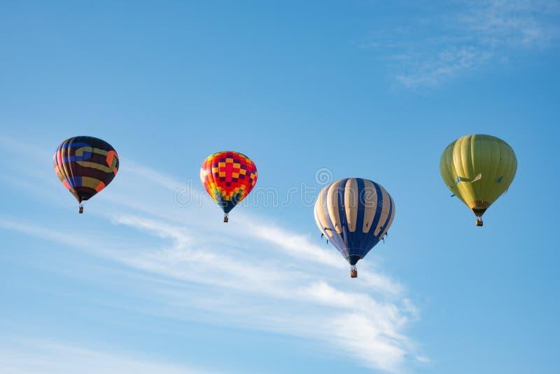 Quatro balões em seguido imagens de stock royalty free