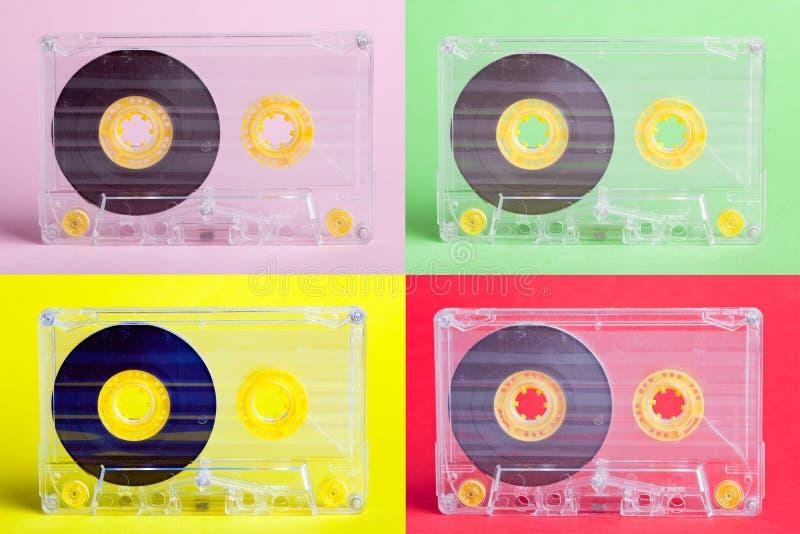 Quatro cassetes áudio em fundos difrent fotografia de stock