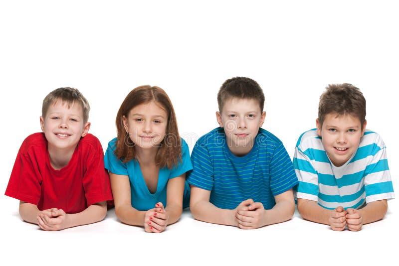 Quatro crianças no fundo branco imagem de stock royalty free