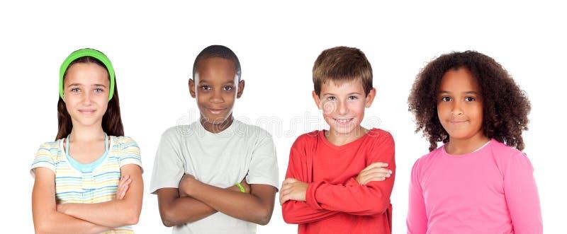 Quatro crianças que olham a câmera foto de stock royalty free
