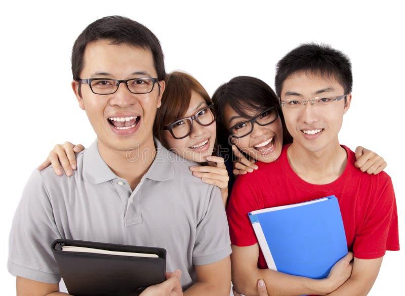 Download Quatro Estudantes Felizes Que Estão Junto Imagem de Stock - Imagem de preensão, fundo: 16862241