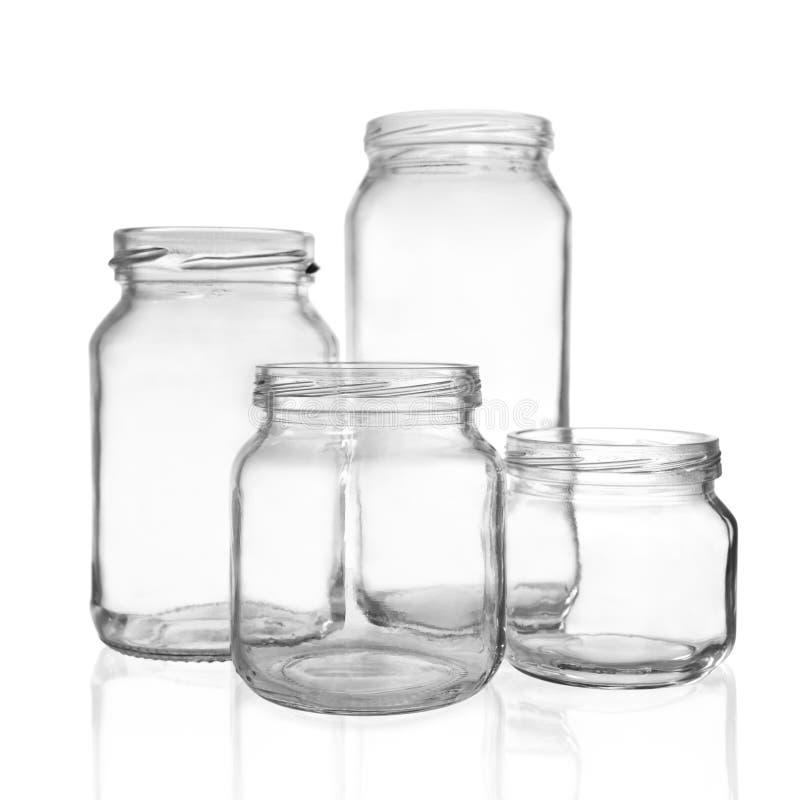 Quatro frascos de vidro imagens de stock