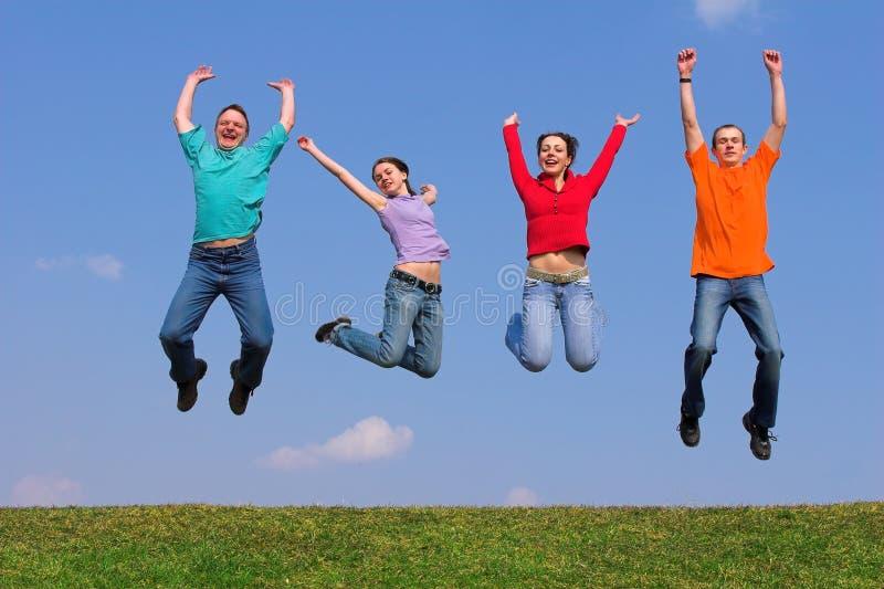 Quatro jovens no vôo imagem de stock royalty free