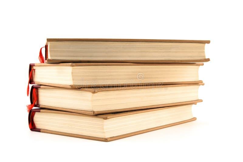 Quatro livros de hardcover no branco imagens de stock royalty free