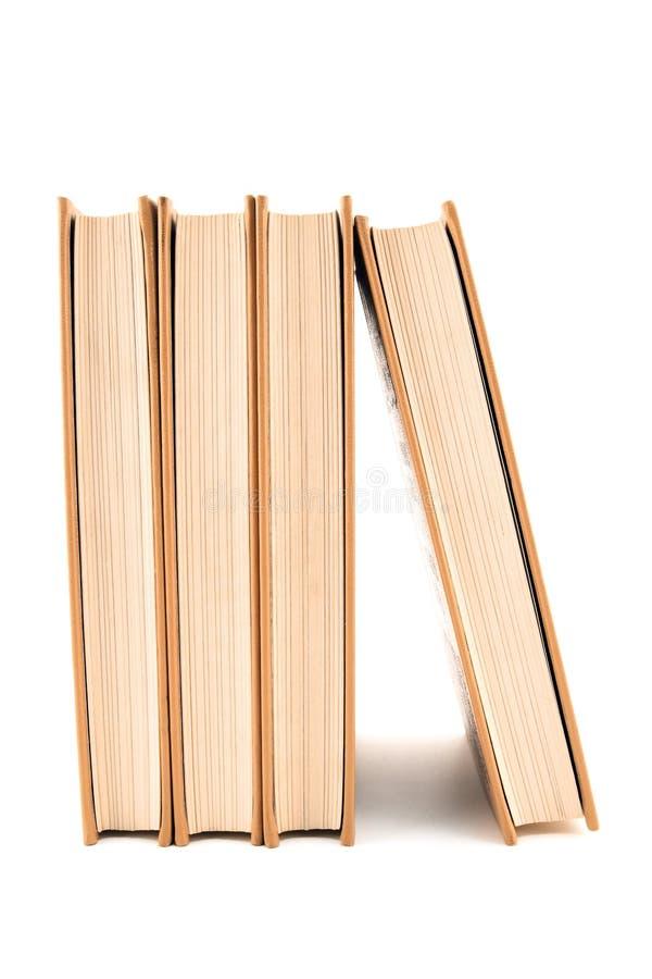 Quatro livros no fundo branco fotografia de stock