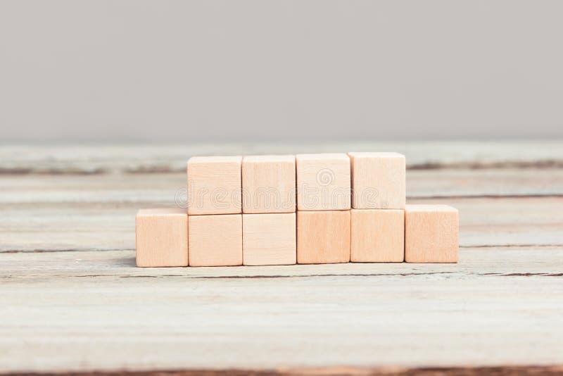 Quatro mais seis cubos de madeira vazios imagem de stock