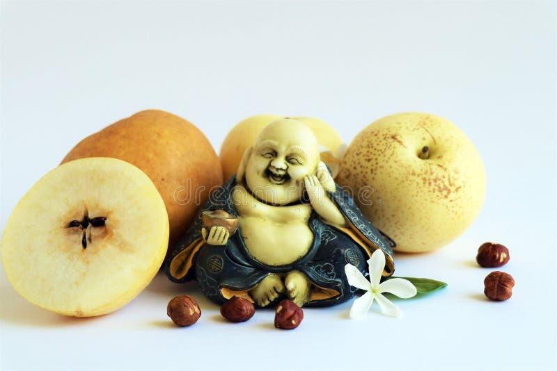 Quatro peras dos asiáticos com Buda de sorriso fotos de stock royalty free