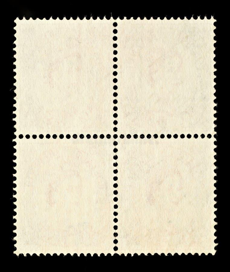 Quatro selos de porte postal em branco imagem de stock