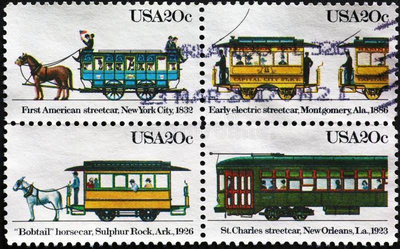 Quatro teleféricos velhos em selos postais americanos foto de stock
