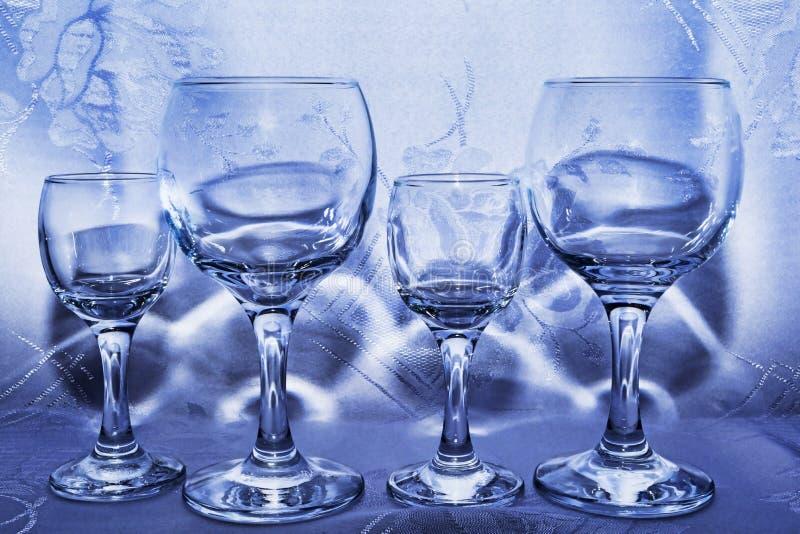 Quatro vidros em uma janela da loja foto de stock royalty free