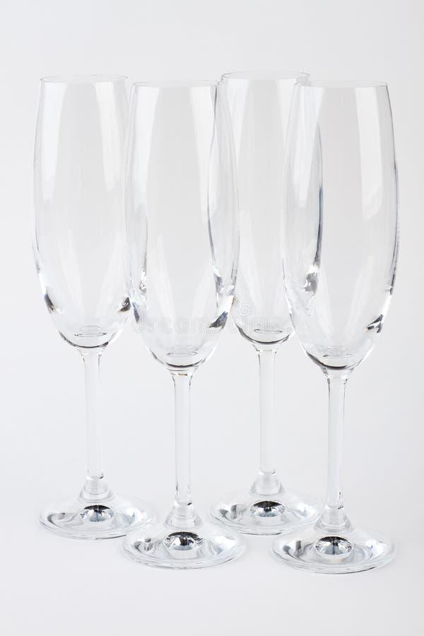 Quatro vidros frágeis do champanhe isolados imagens de stock royalty free