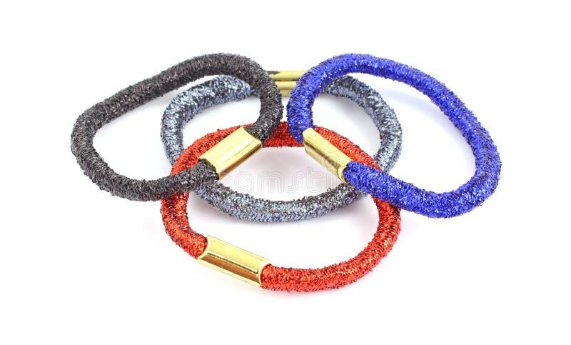 Quattro anelli variopinti dei capelli di stirata fotografia stock
