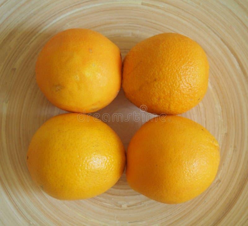 Quattro arance fresche fotografia stock