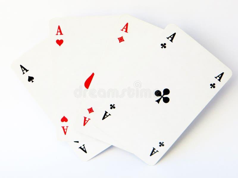 Quattro assi dai giochi con le carte progettati classici hanno disposto come un fan fotografia stock libera da diritti