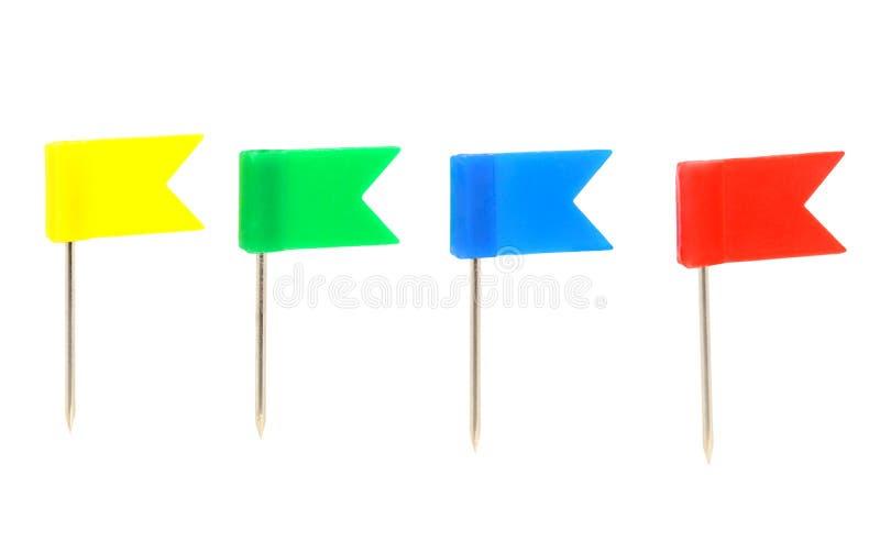 Quattro bandierine di colore - a pressione fotografie stock libere da diritti