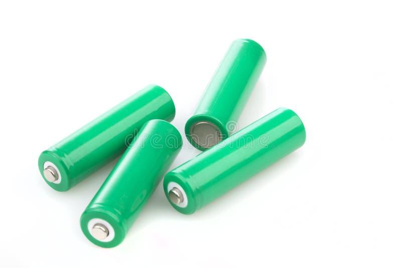 Quattro batterie verdi ricaricabili di eco immagini stock