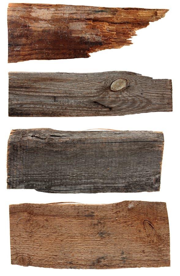 Quattro bordi di legno anziani isolati su un bianco fotografia stock