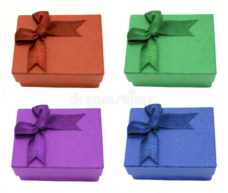 Quattro contenitori di regalo con gli archi fotografia stock