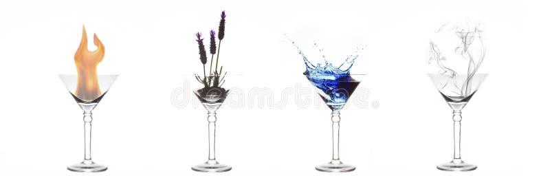 Quattro elementi di fuoco, della pianta, dell'acqua e dell'aria in vetri di martini fotografia stock libera da diritti