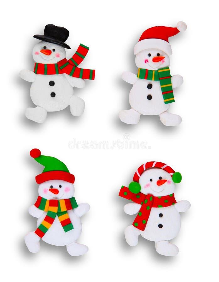 Quattro pupazzi di neve sopra bianco fotografia stock libera da diritti