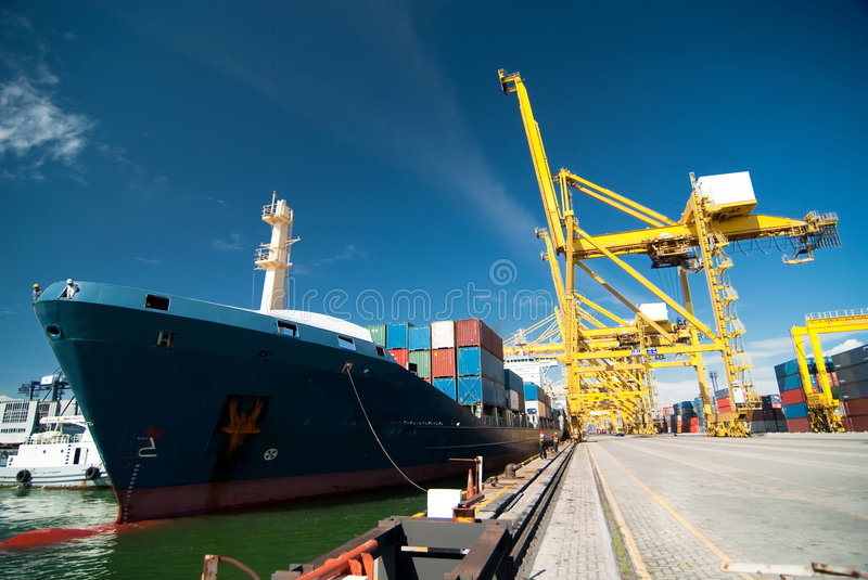 Quay crane and container ship stock photography