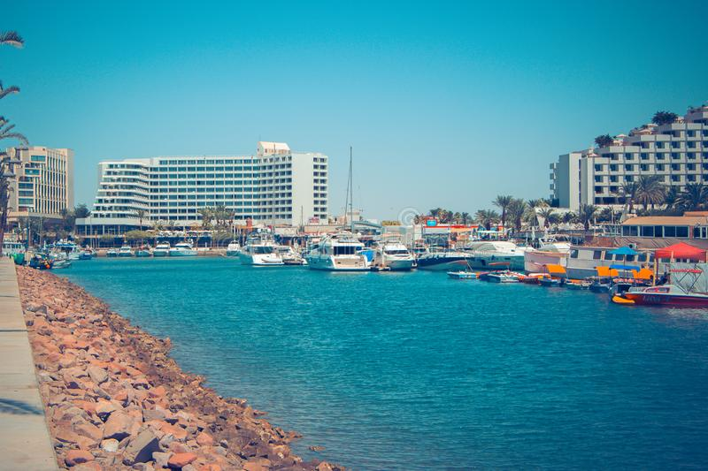 Panorama of Eilat attractions with watercraft and five-star hotels royalty free stock photography
