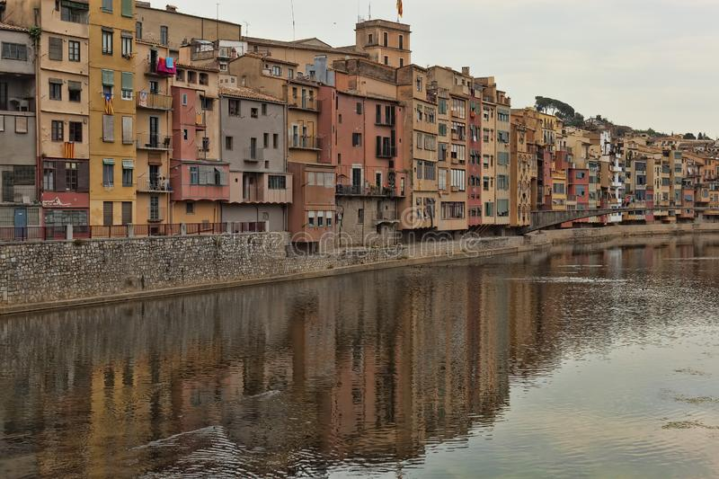 Quay Girona on July 17, 2013. Well preserved since the Middle Ages the historic core of the city attracts a significant number of. GIRONA, SPAIN - JULY 17, 2013 stock photos