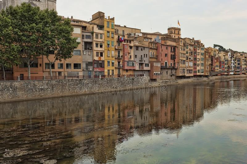 Quay Girona on July 17, 2013. Well preserved since the Middle Ages the historic core of the city attracts a significant number of. GIRONA, SPAIN - JULY 17, 2013 stock photo