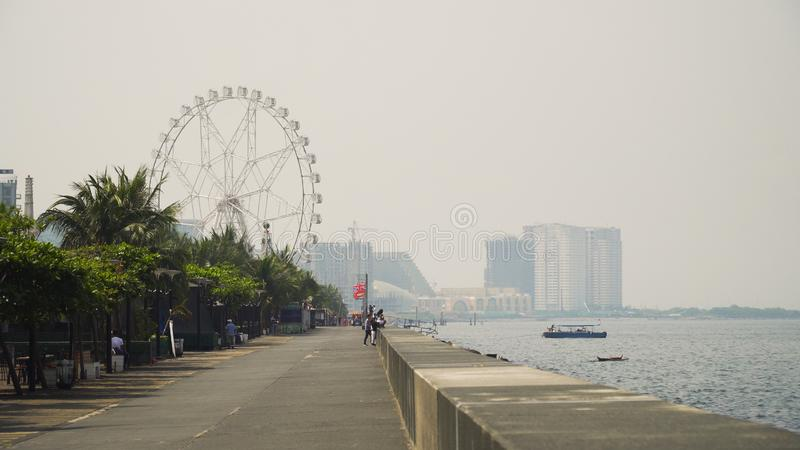 City with skyscrapers and buildings. Philippines, Manila, Makati. Quay near the Mall of Asia. Panorama Manila city, skyscrapers and buildings. Seascape coastal royalty free stock image