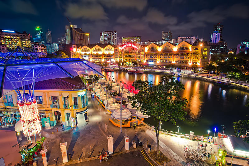 quay singapore ночи clarke стоковое изображение rf