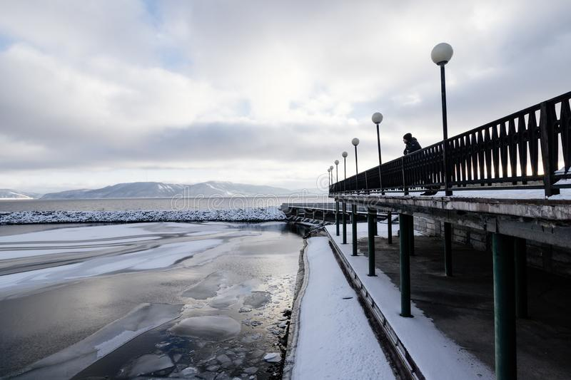 Quayside in cold weather. My friend and me travelled to Tolyatti city in Cold season and with cold mountains royalty free stock photos