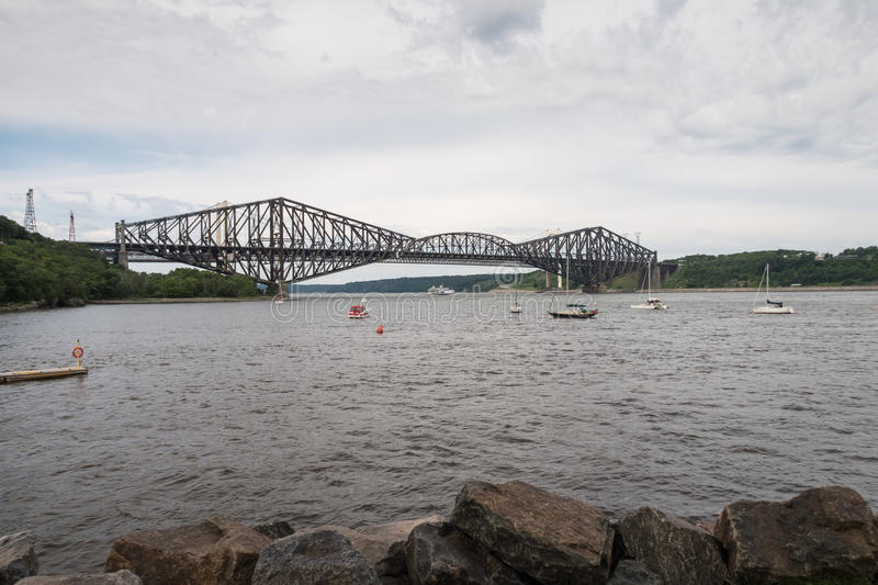Quebec Bridge - longest cantilever bridge in the world. The Quebec Bridge is a riveted steel truss structure and is still the longest cantilever bridge span in stock photography