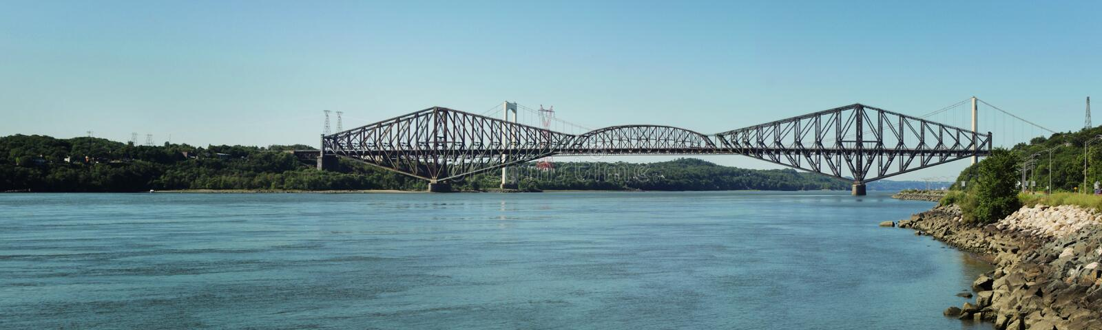 Quebec bridge. View of The Quebec Bridge is a road, rail and pedestrian bridge across the lower Saint Lawrence River to the west of Quebec City. The project stock photo