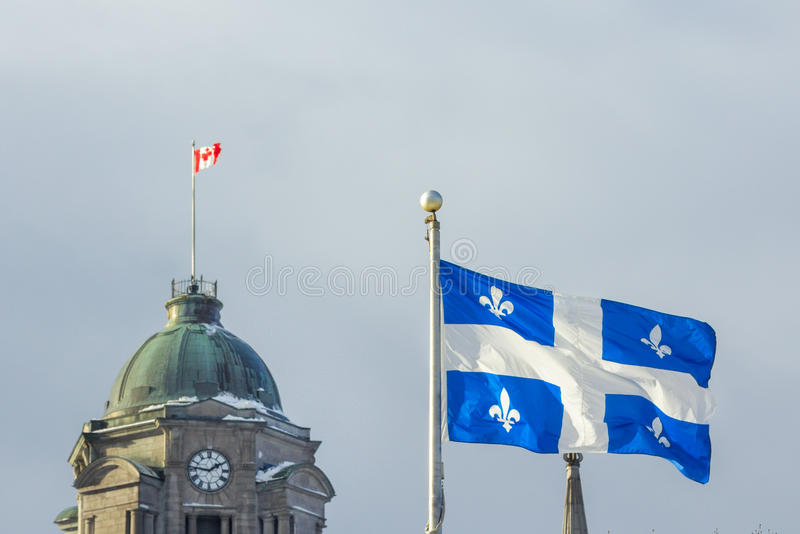 Quebec and Canadian flags in Quebec City, QC, Canada royalty free stock photography