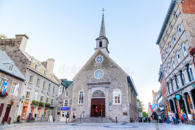 Historic Stone Church at Place Royale in Old Quebec City. QUEBEC CITY, CANADA - AUG 21, 2012: Tourists meander the cobblestone streets of Place Royale in Old stock images