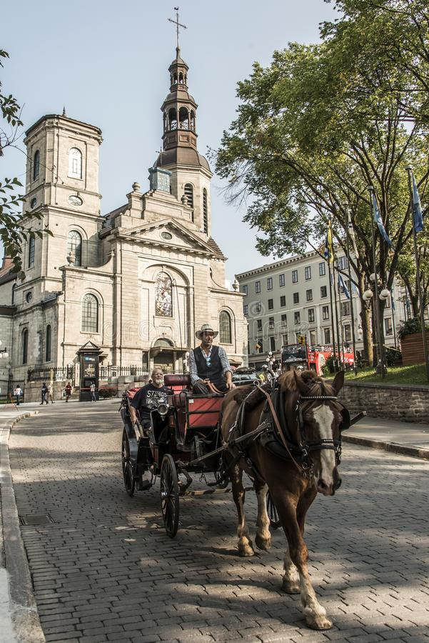 Quebec City Canada 13.09.2017 Touristic Horse carriage in front of Cathedral basilica of Notre-Dame Quebec part Old town royalty free stock photo