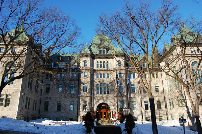 Quebec City City Hall, Quebec, Canada. The Hotel de Ville (City Hall) seen from the small park in its ground in winter, Quebec City, Quebec, Canada royalty free stock photography