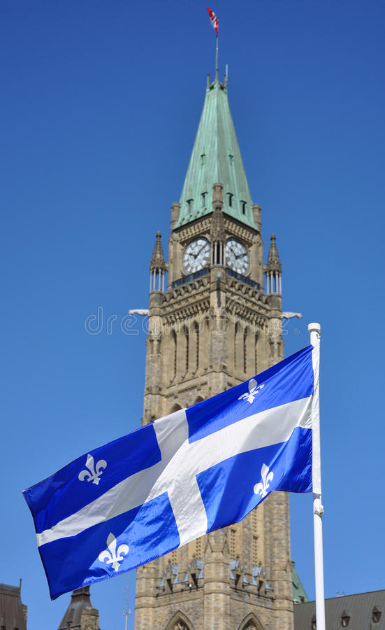 Quebec Flag flying in front of Peace Tower, Ottawa royalty free stock photography