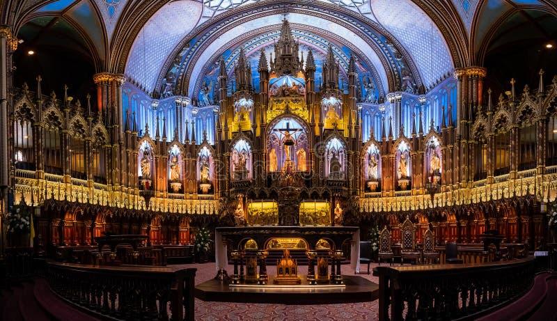 Interior view of the famous Basilique Notre-dame De Montreal. Quebec, OCT 2: Basilique Notre-dame De Montreal on OCT 2, 2018 at Quebec, Canada stock photography