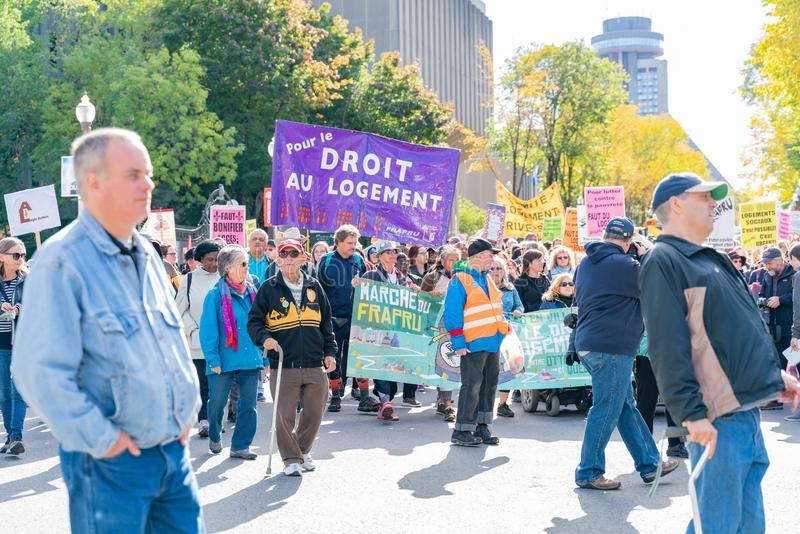 Many people marching in old Quebec. Quebec, OCT 2: Many people marching in old Quebec on OCT 2, 2018 at Quebec, Canada royalty free stock images