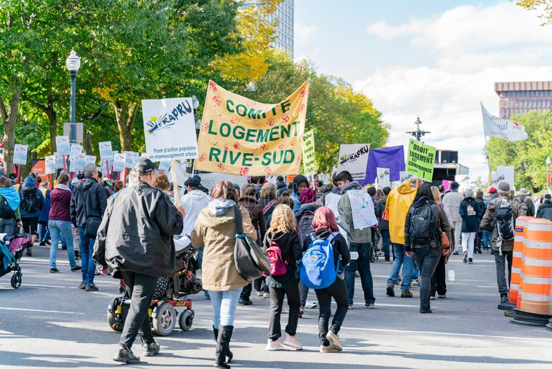 Many people marching in old Quebec. Quebec, OCT 2: Many people marching in old Quebec on OCT 2, 2018 at Quebec, Canada stock photos