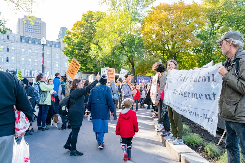 Many people marching in old Quebec. Quebec, OCT 2: Many people marching in old Quebec on OCT 2, 2018 at Quebec, Canada stock images