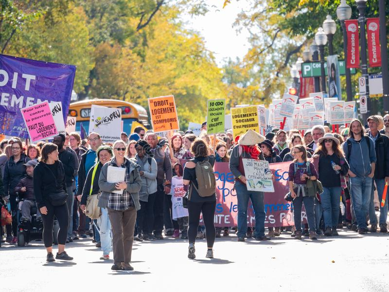 Many people marching in old Quebec. Quebec, OCT 2: Many people marching in old Quebec on OCT 2, 2018 at Quebec, Canada stock image