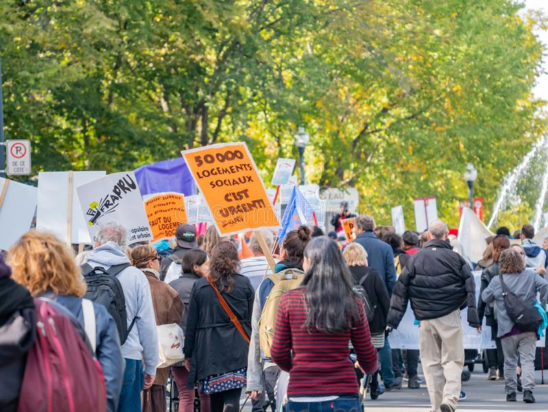 Many people marching in old Quebec. Quebec, OCT 2: Many people marching in old Quebec on OCT 2, 2018 at Quebec, Canada royalty free stock image