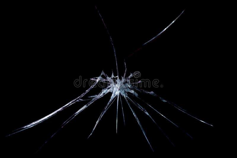 Quebra em um close-up de vidro quebrado em um fundo preto imagens de stock