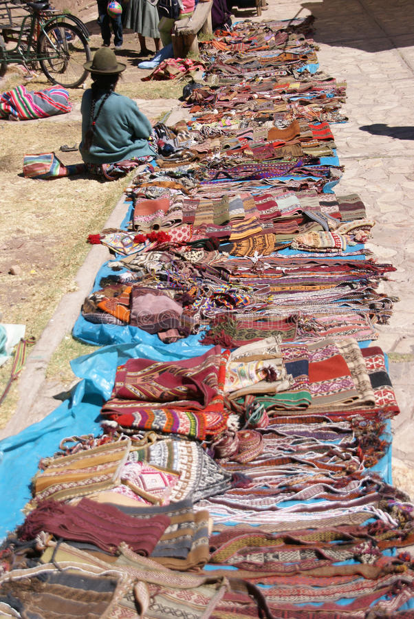 Quechua Indian woman selling blankets royalty free stock photo