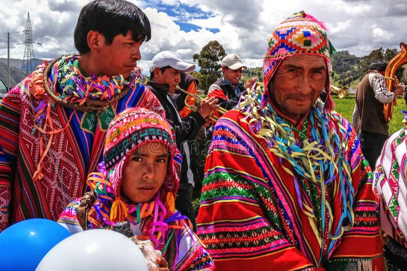 Quechua native men from Peru in traditional costumes royalty free stock image