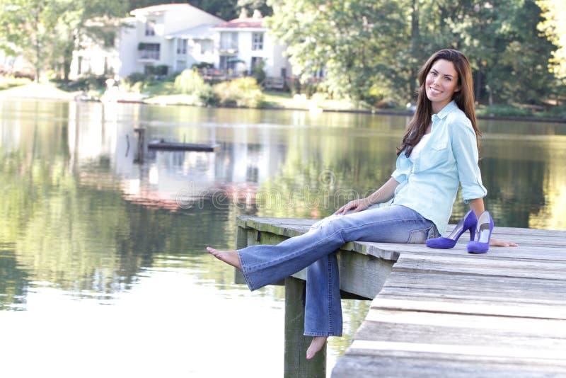 Queda da mulher, lago fotos de stock royalty free